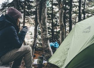 girl camping and drinking coffee