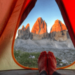 pitching a tent: camping environment feet grass