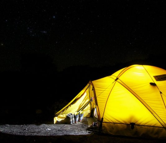 ez up tent: yellow tent under starry nigh