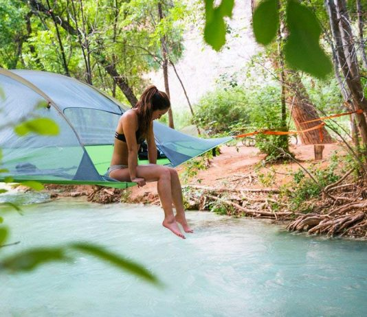 Woman Sitting on the Tentsile Tent Stingray Model Tree House Tent Over the River