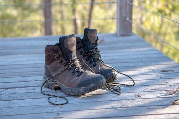 pair of columbia hiking boots on a wood deck