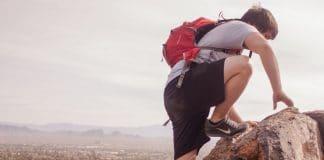 Hiker on the boulder wearing black nike hiking boots