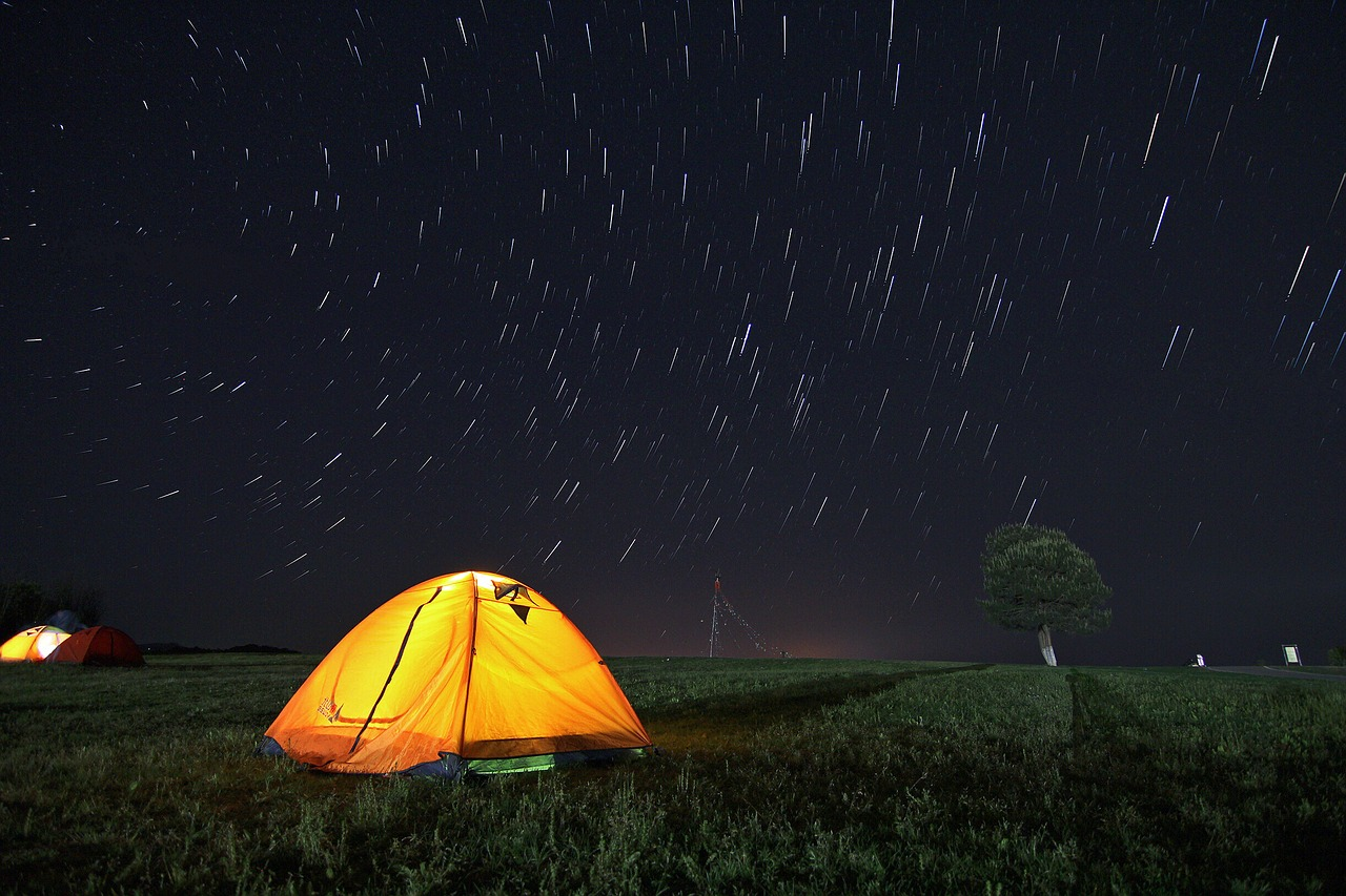 Yellow tent under a beautiful night sky